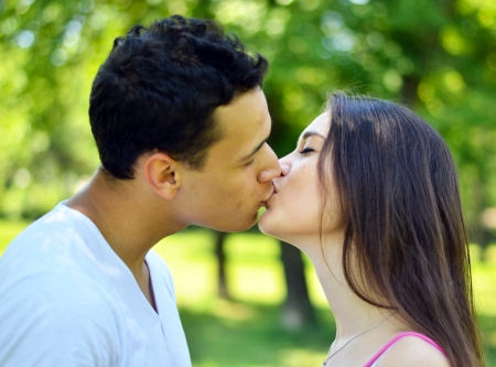 Young couple kissing outdoor photo