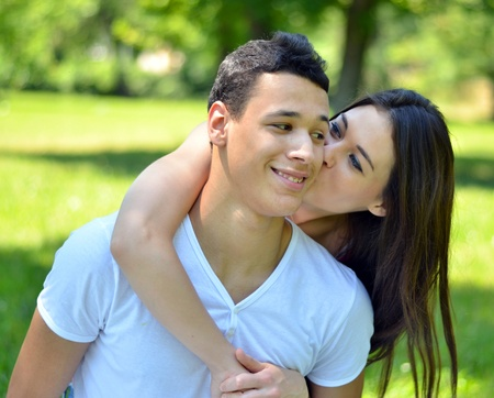 Couple hugging in park photo