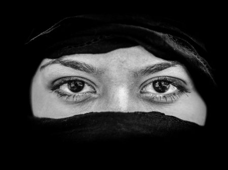 iraq: Portrait of beautiful Arab woman wearing black scarf in black and white