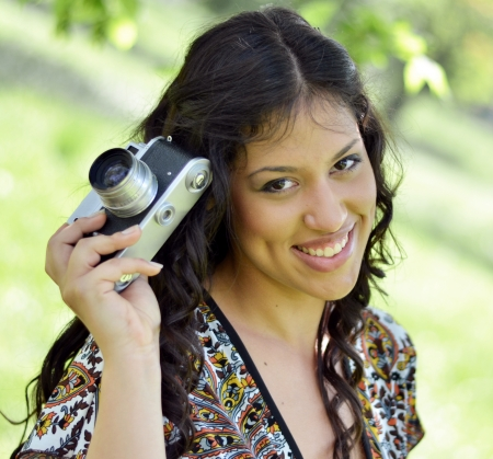 Retro image of beautiful woman holding vintage camera Stock Photo - 21165982