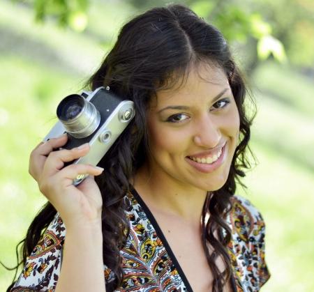 Retro image of beautiful woman holding vintage camera Stock Photo - 21165982