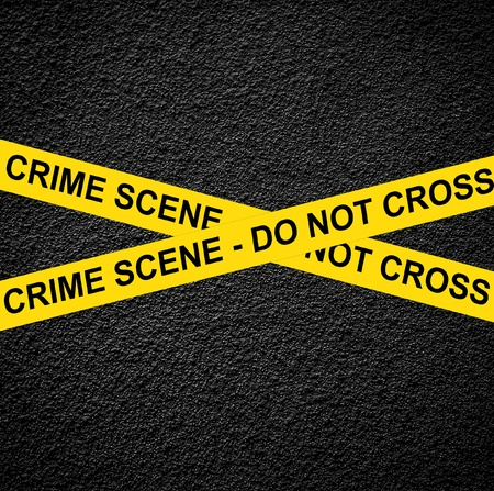 CRIME SCENE - DO NOT CROSS against black wall photo