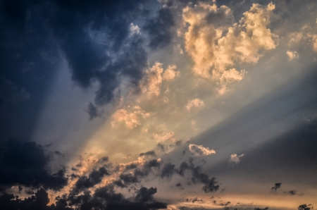 Light rays shine through the dark clouds photo