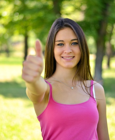 Pretty young smiling woman showing gesture that everything is ok Stock Photo