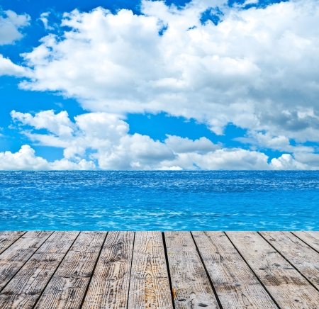 tropical island: Tropical sea and wooden floor background Stock Photo