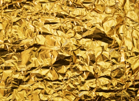 Wrinkled golden foil background photo