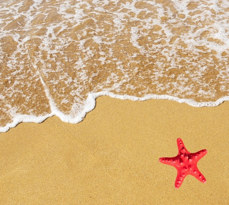 Sand beach and wave with red star photo