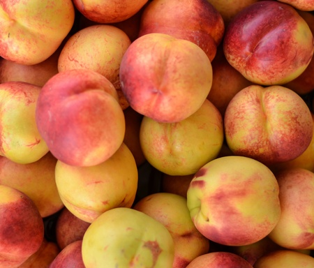 Fresh peaches at market photo