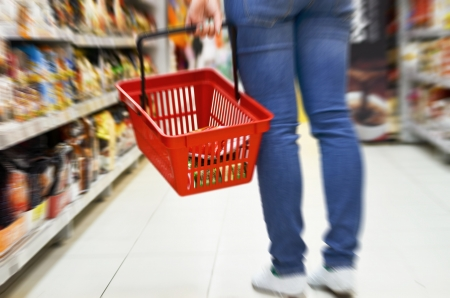 Hand holding empty shopping basket - Shopping concept  Imagens