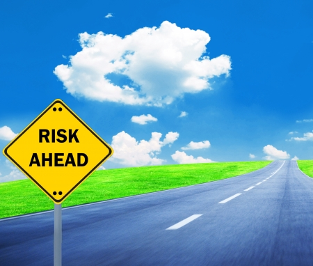 'RISK AHEAD' sign - Business concept photo