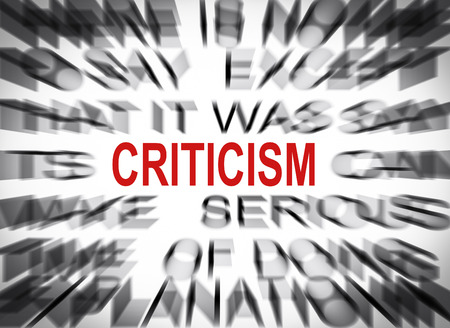 criticism: Blured text with focus on CRITICISM Stock Photo