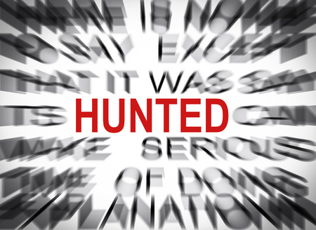 hunted: Blured text with focus on HUNTED Stock Photo