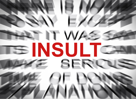 insult: Blured text with focus on INSULT Stock Photo
