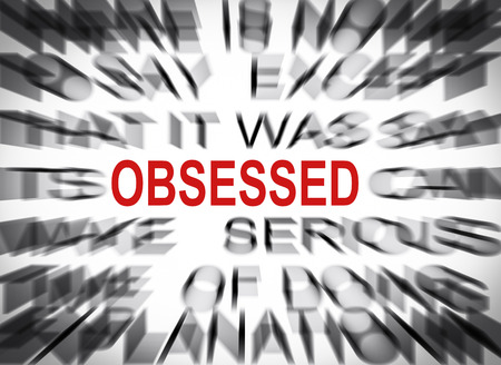 obsessed: Blured text with focus on OBSESSED