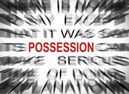 possession: Blured text with focus on POSSESSION Stock Photo