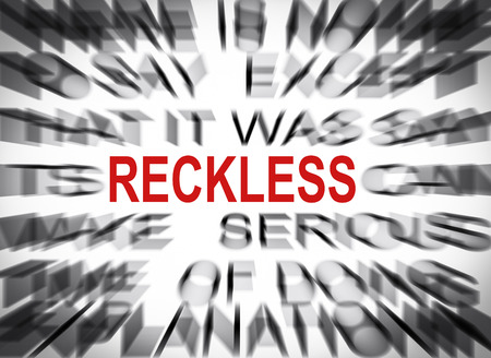 reckless: Blured text with focus on RECKLESS Stock Photo