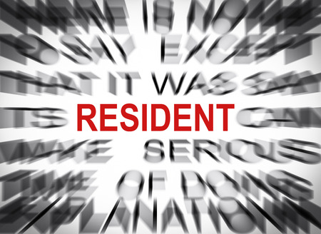 resident: Blured text with focus on RESIDENT Stock Photo