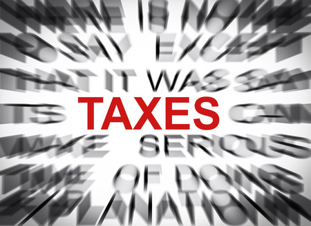 tax tips: Blured text with focus on TAXES