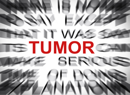 Blured text with focus on TUMOR Stock Photo
