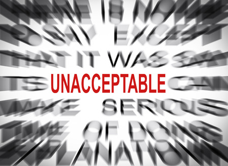 unacceptable: Blured text with focus on UNACCEPTABLE