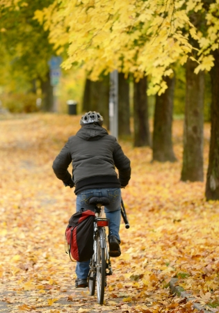 Biker driving at park in Autumn photo