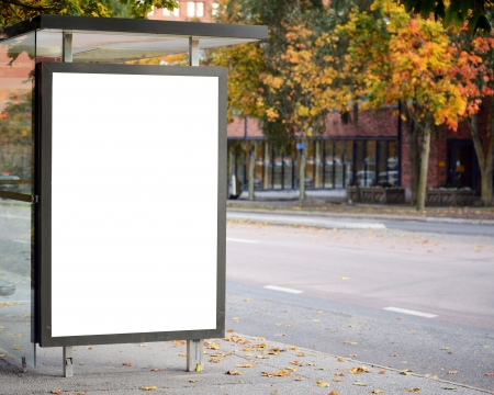 Blank billboard on city bus station Фото со стока