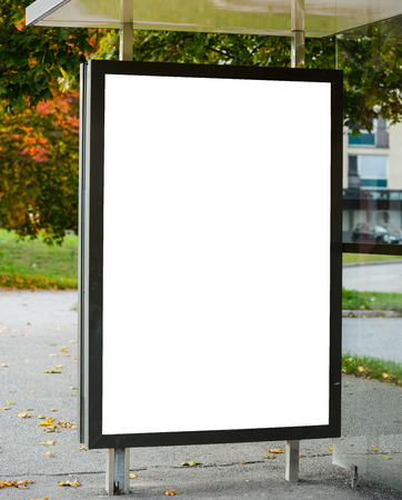 billboard posting: Blank billboard on city bus station Stock Photo