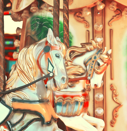 carousel horse: Carousel -  Fair conceptual background with horses in vintage tones Stock Photo
