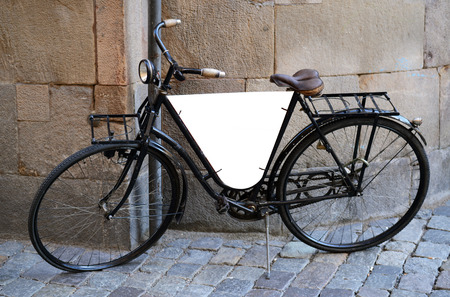 advertisment: Retro looking bicycle with blank board for your advertisment Stock Photo