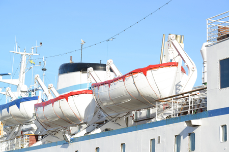 installed: Lifeboats installed on large white passenger liner deck