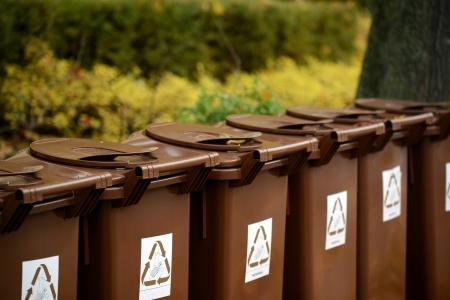 segregate: Recycle bins outdoors