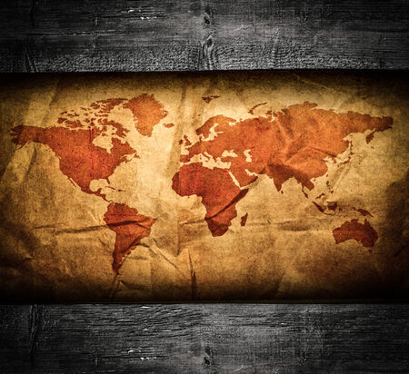 Antique world map in grunge wooden frame photo