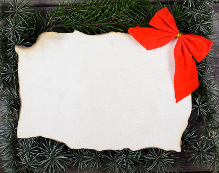Christmas decoration and vintage paper on wooden background photo