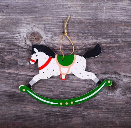 Christmas decorative ornament - Horse ornament on wooden background photo