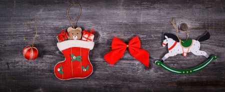 Christmas decorative ornaments on wooden background photo