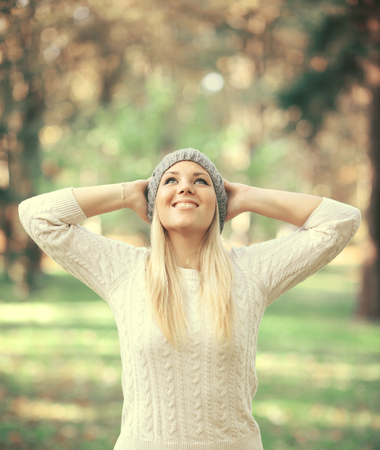 Happy woman looking up in the sky in Autumn forest Stock Photo - 23738069