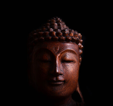 Buddha portrait against black background photo