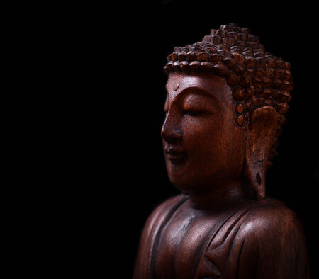Buddha portrait against dark background photo