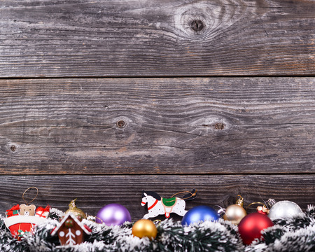Christmas background with various colorful decorations on wooden wall photo