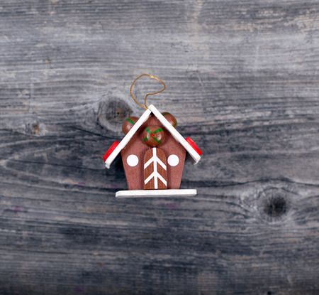 Christmas decorative ornament - Cake house on wooden background photo