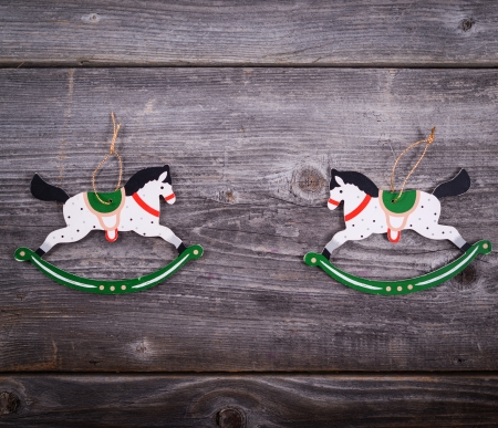 Christmas decorative ornament - Two wooden horses on wooden background photo