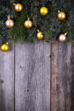 Christmas fir tree with golden decoration on a wooden board photo