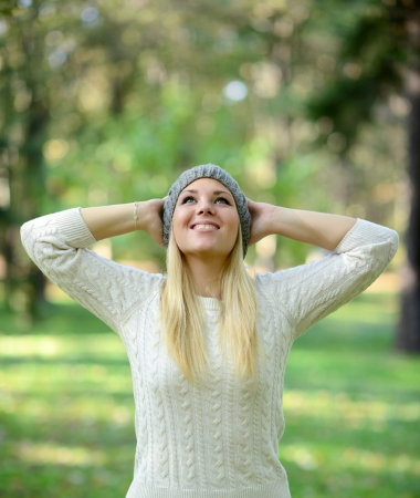 Happy woman looking up in the sky in forest Stock Photo - 23747315