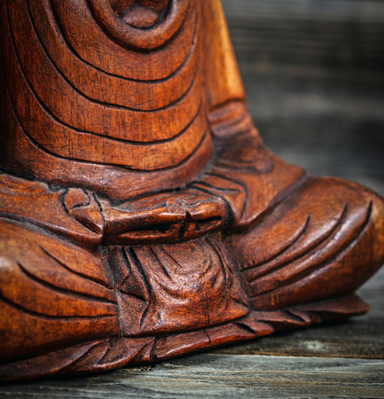 Meditation conceptual image with focus on Buddhas hands Stock Photo - 23747322