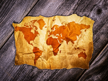 Old world map over wooden background photo