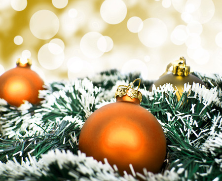 Orange christmas ornament ball against yellow bokeh background photo