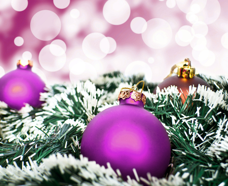 Purple christmas ornament ball against purple bokeh background photo