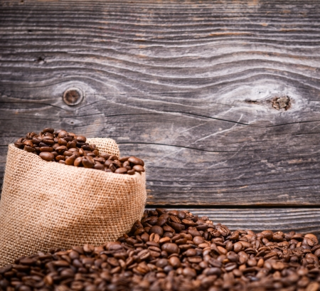 finite: Sack of coffee beans on wood background