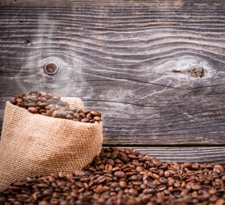 finite: Sack of fresh coffee beans with smoke Stock Photo