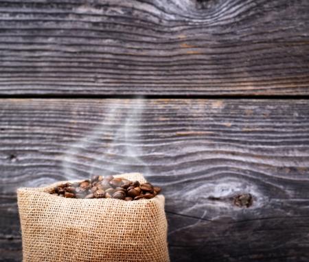 Sack of fresh coffee beans with smoke Stock Photo - 23747432